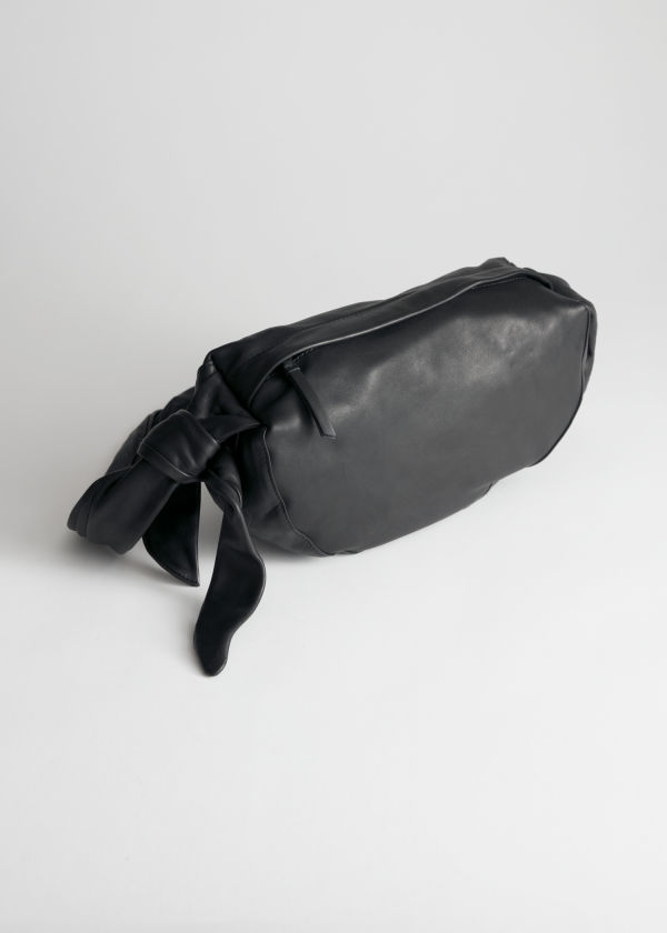Front image of Stories side knot half moon bag in black