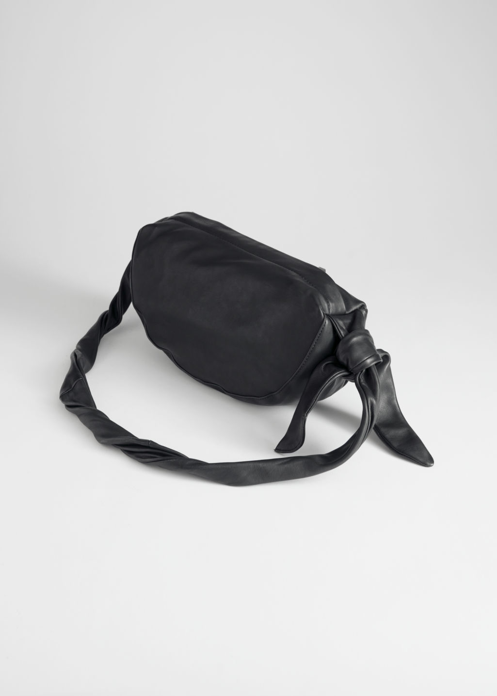 Back image of Stories side knot half moon bag in black