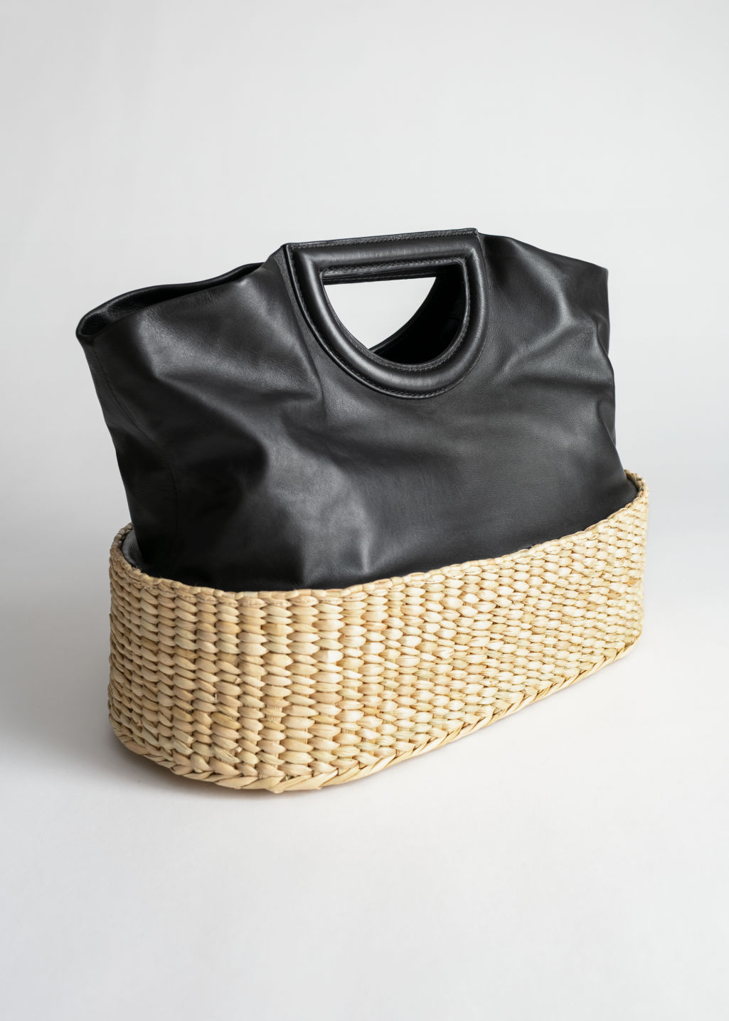 Front image of Stories structured leather straw tote in black