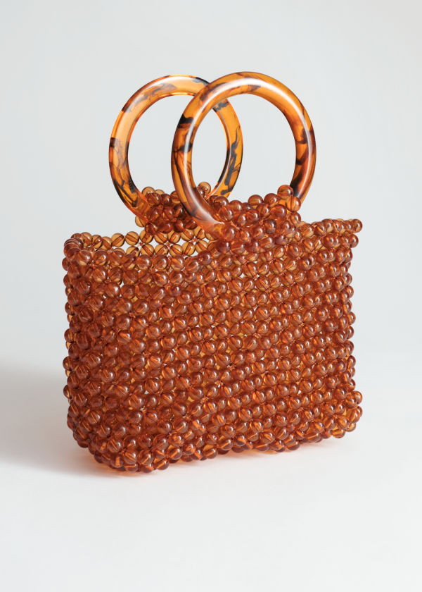 Front image of Stories circle handle beaded bag in brown
