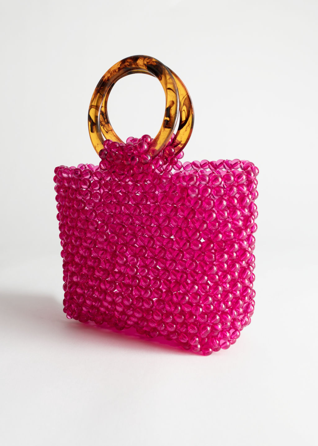 Back image of Stories circle handle beaded bag in pink