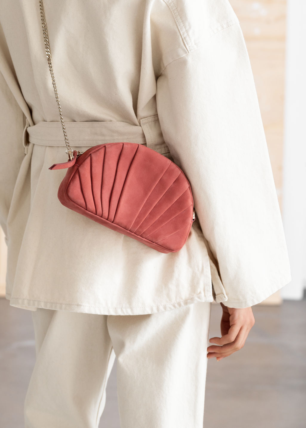 Back image of Stories pleated half moon suede crossbody bag in red