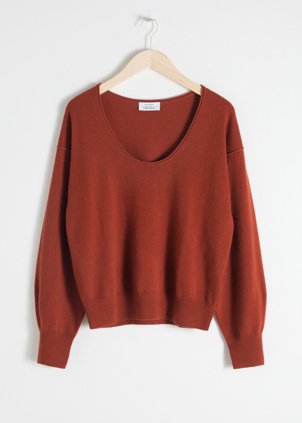 Front image of Stories scoop neck cashmere sweater in orange