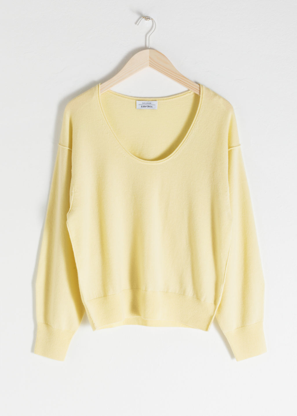 Front image of Stories scoop neck cashmere sweater in yellow