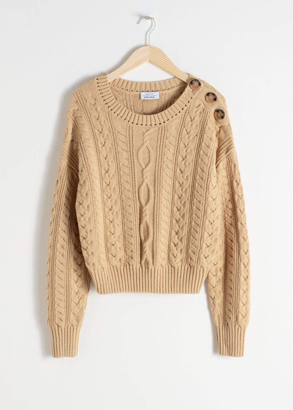 Front image of Stories cotton cable knit sweater in beige