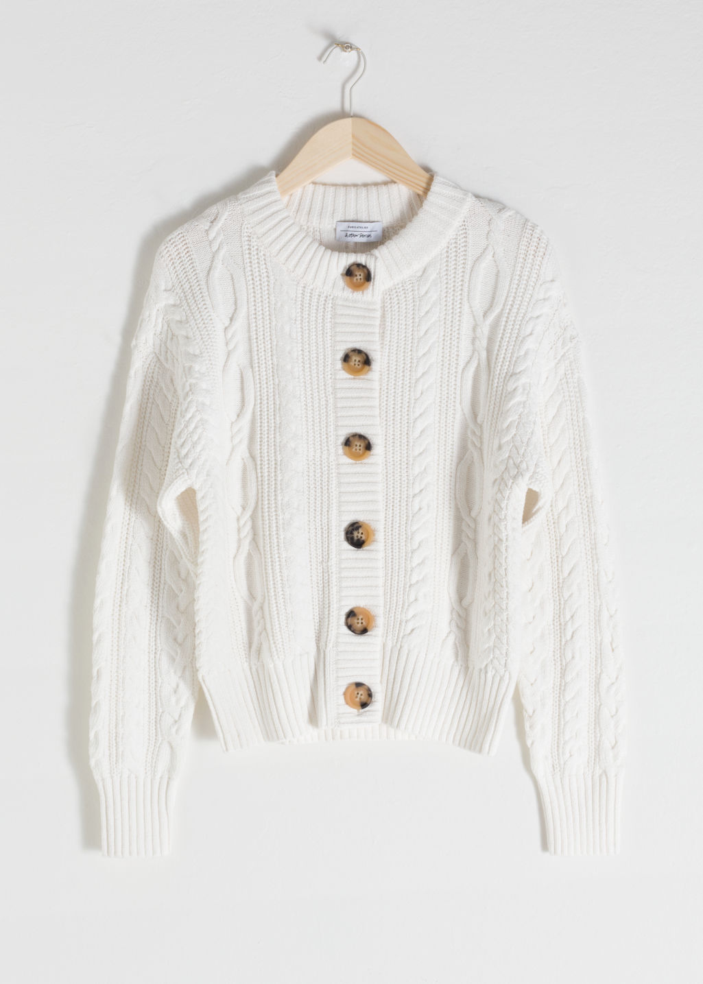 Front image of Stories cable knit cardigan in white