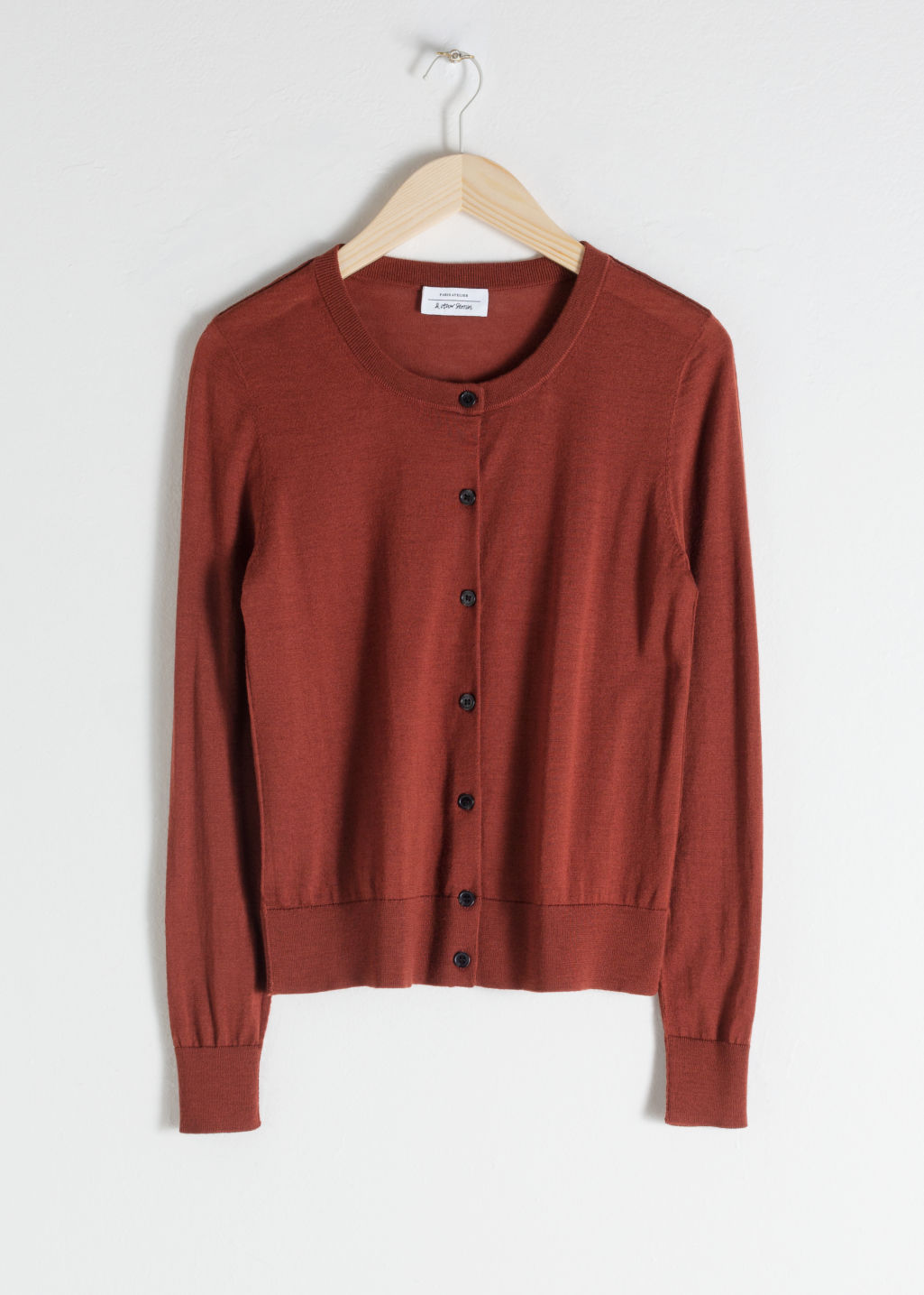 Front image of Stories fitted merino wool cardigan in orange