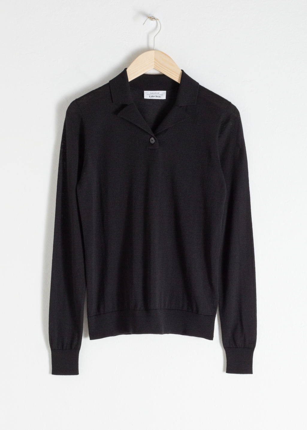Front image of Stories merino wool polo top in black