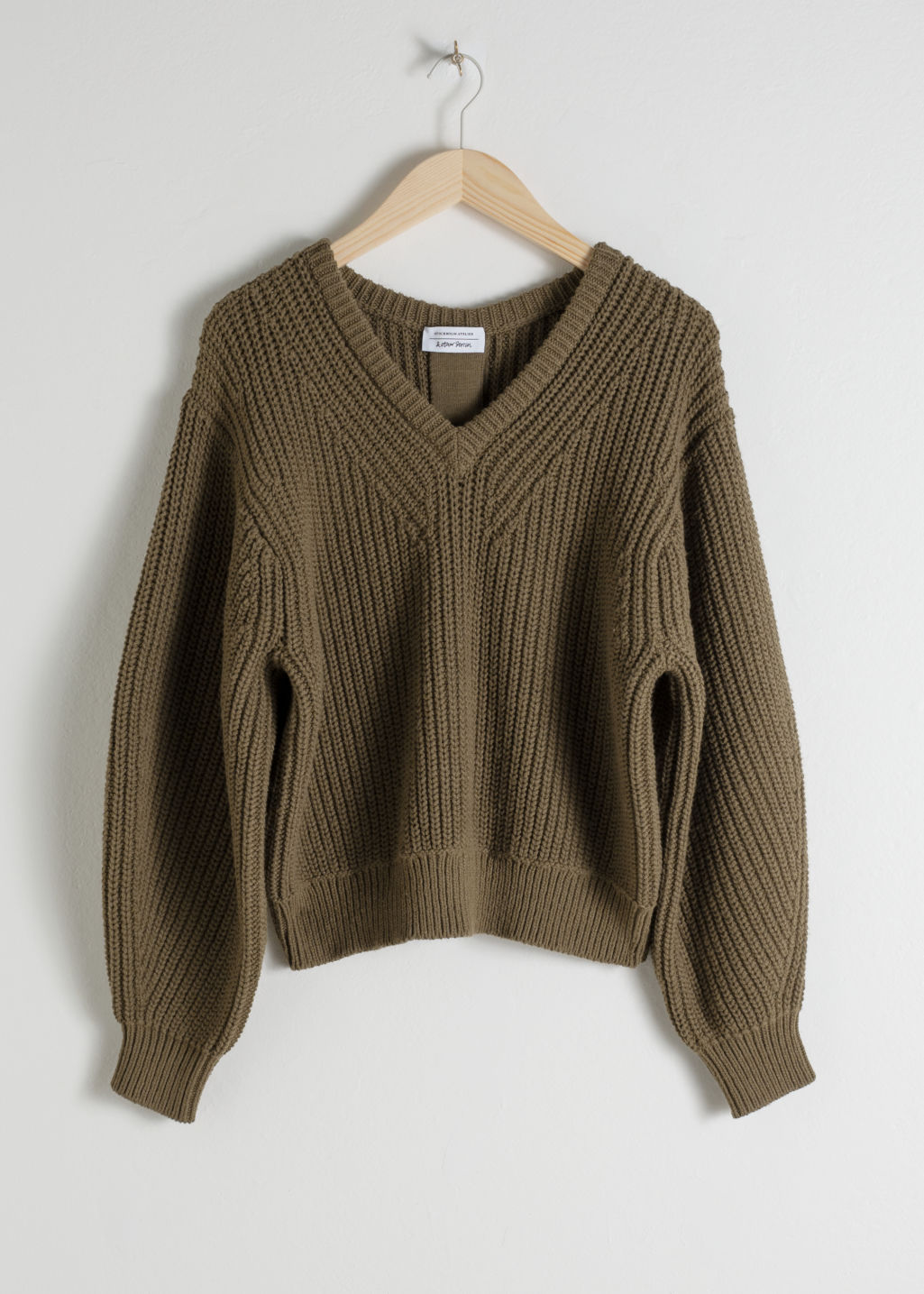 Front image of Stories v-neck rib knit sweater in brown