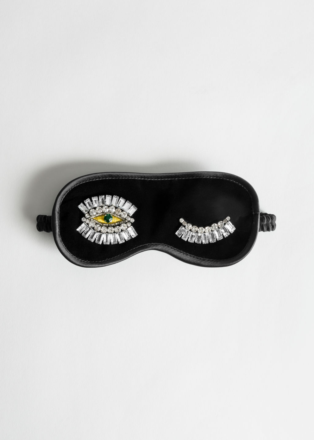 Front image of Stories jewelled wink velvet eyemask in black
