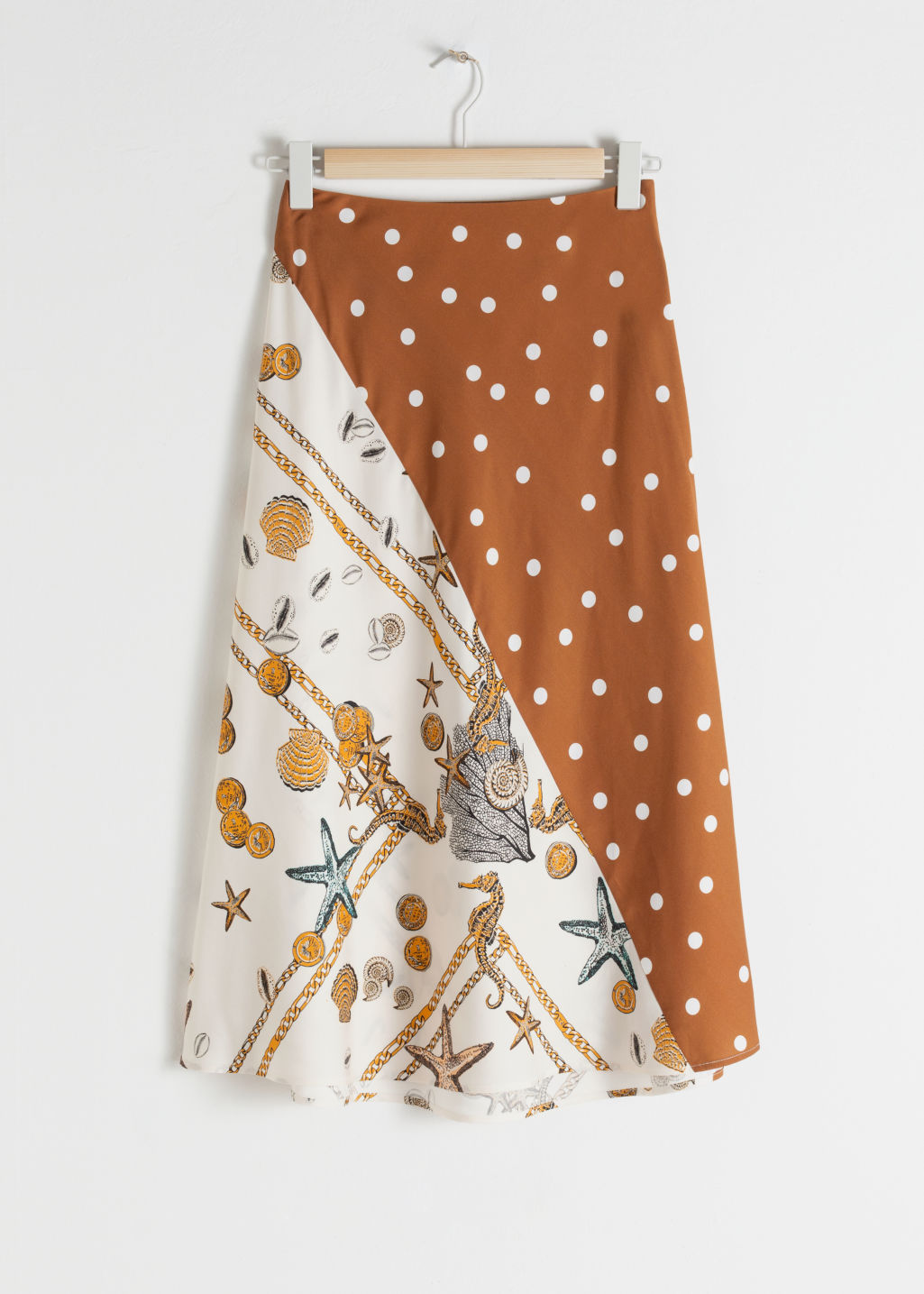 StillLife Front Image of Stories Polka Dot Satin Midi Skirt in Orange