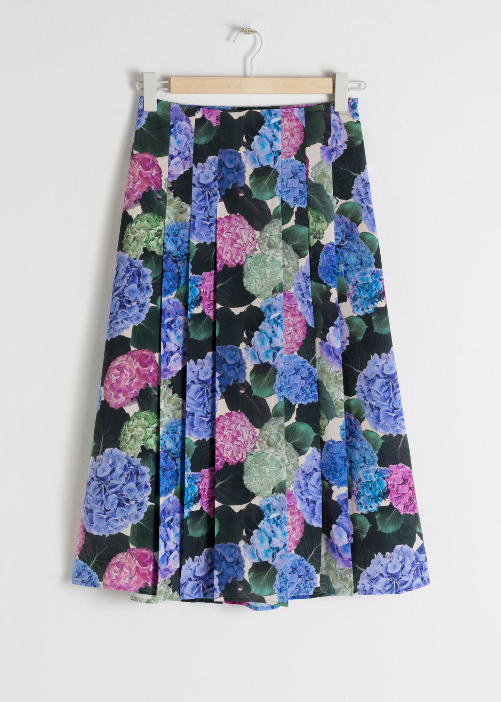 Front image of Stories floral pleated a-line midi skirt in blue