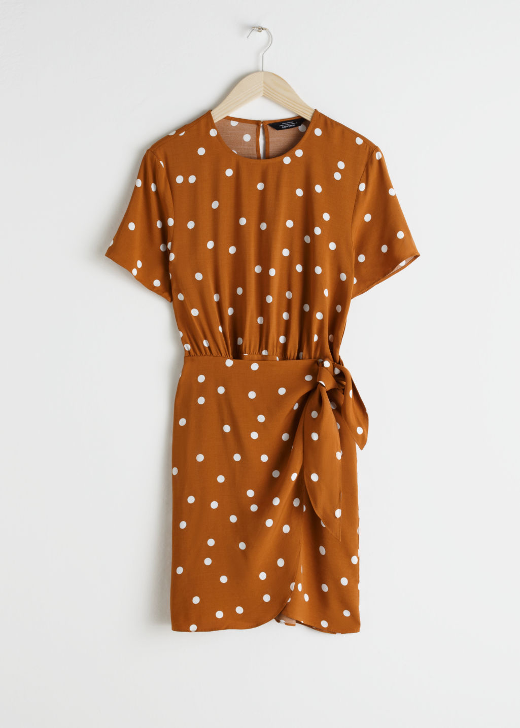 Front image of Stories tie up mini wrap dress in orange