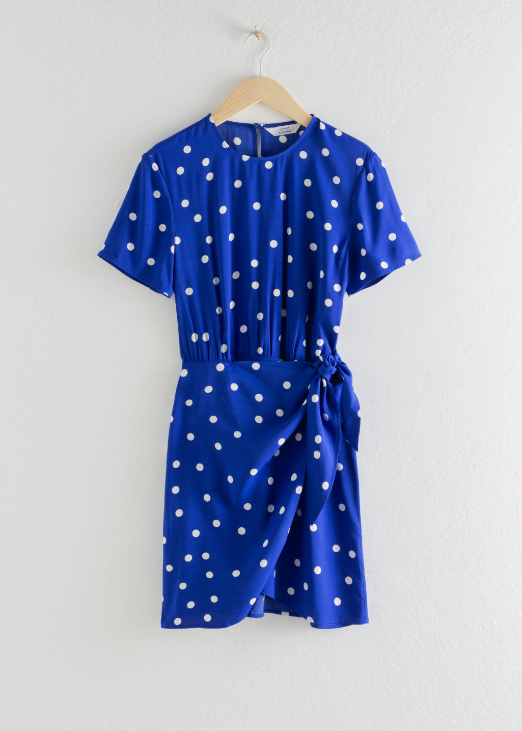 Front image of Stories tie up mini wrap dress in blue