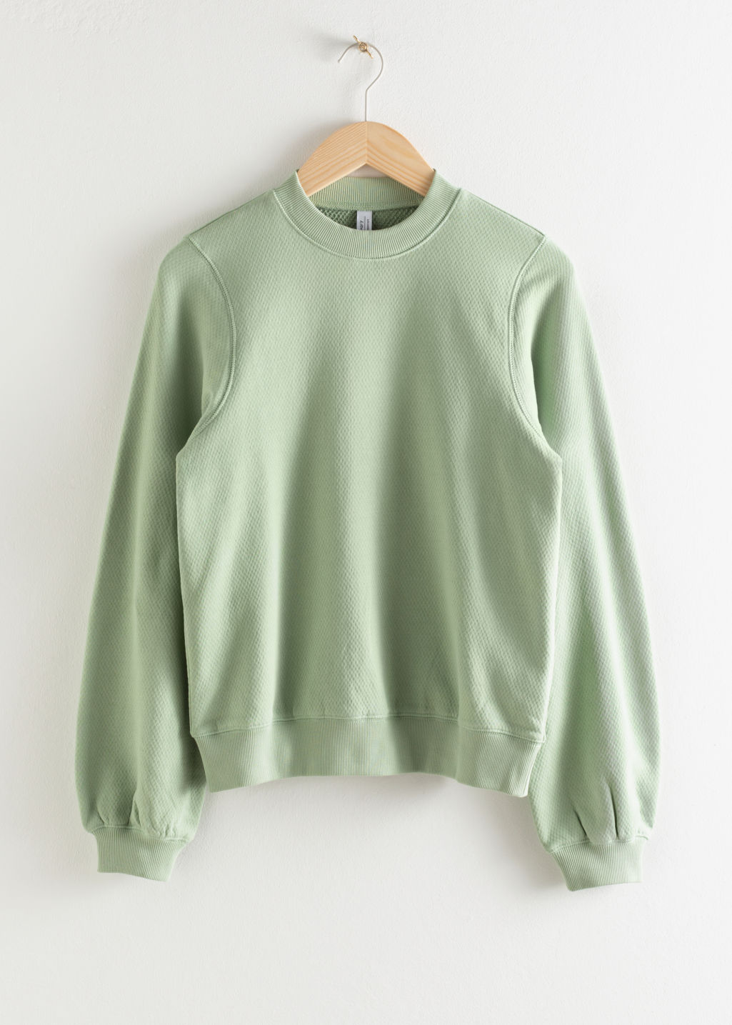 Front image of Stories relaxed organic terry cotton sweater in green