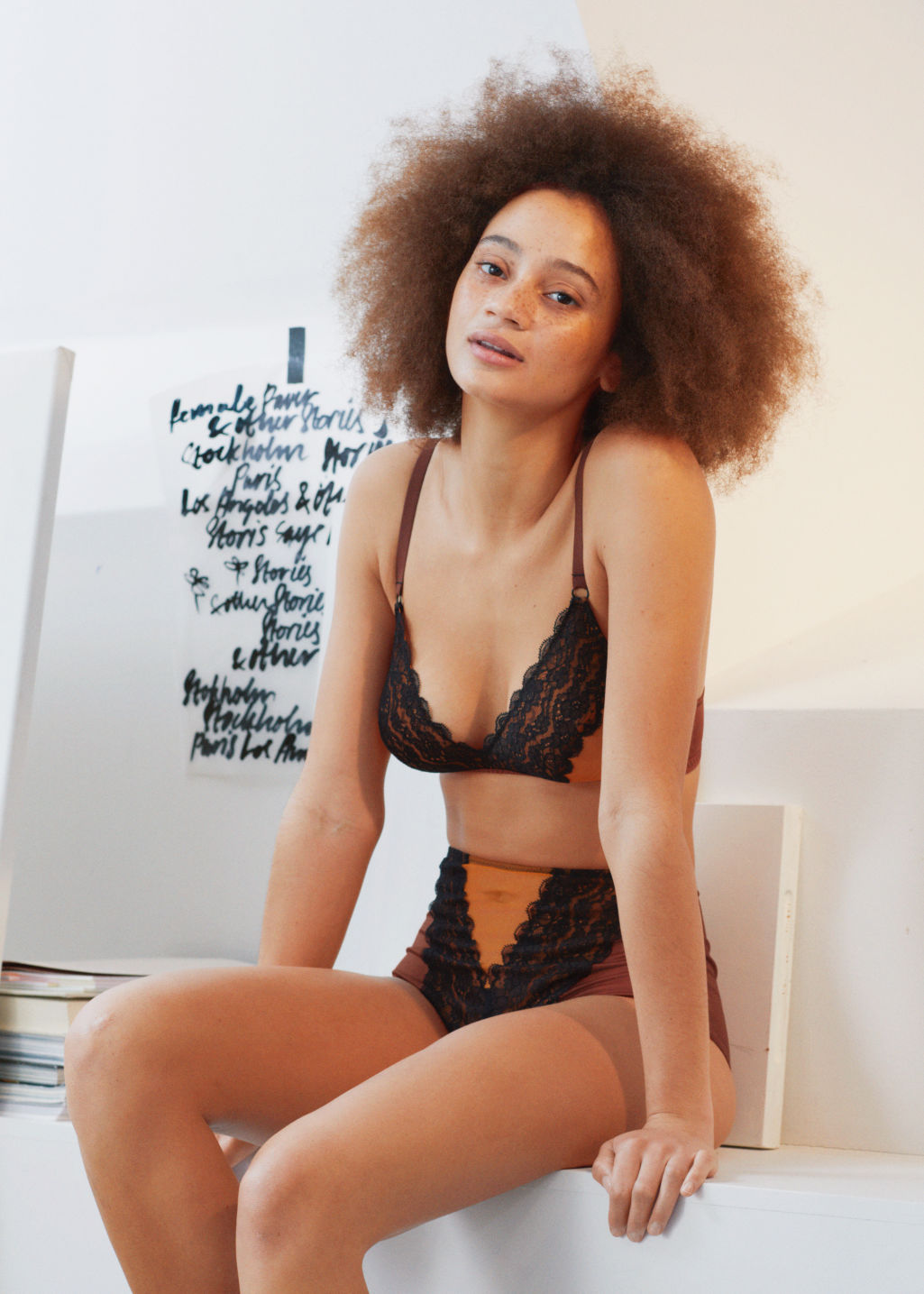 Back image of Stories multicoloured lace triangle bra in black