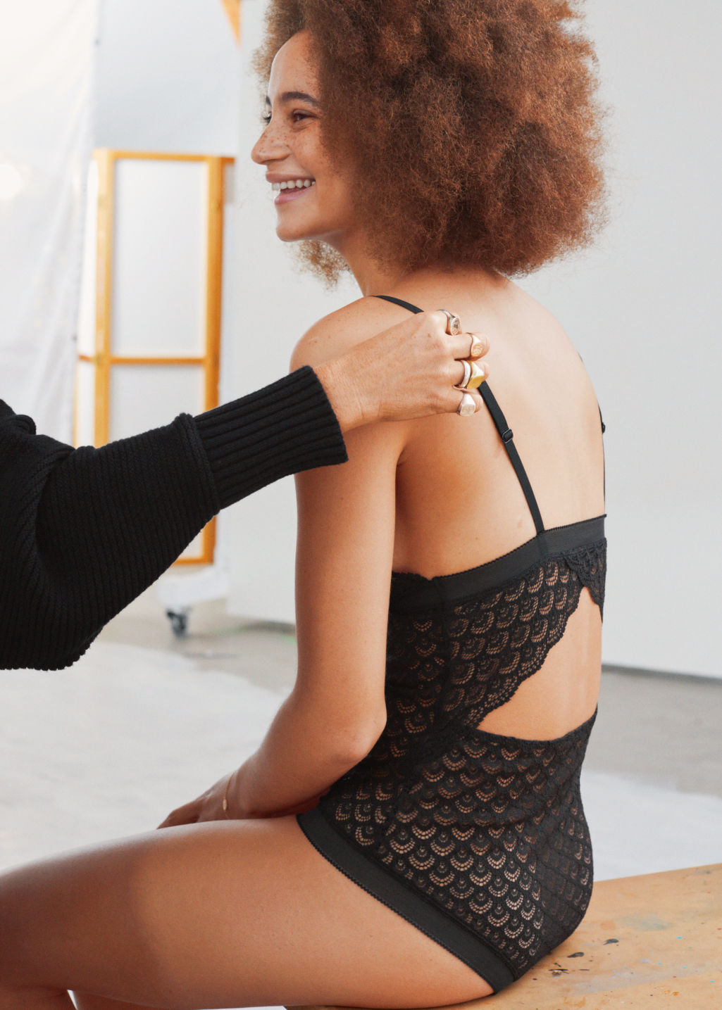 Back image of Stories diamond eyelet lace bodysuit in black
