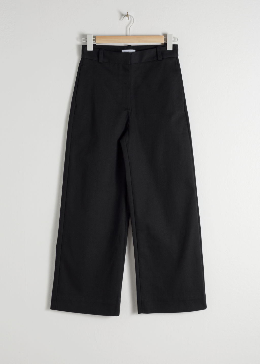 Front image of Stories stretch cotton culotte trousers in black