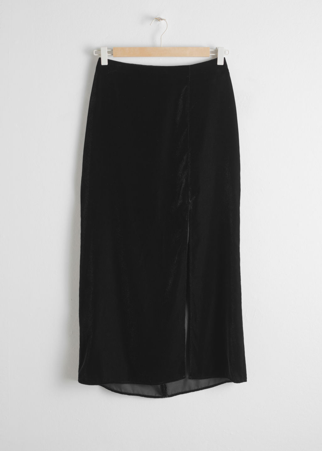 Front image of Stories velvet side slit midi skirt in black