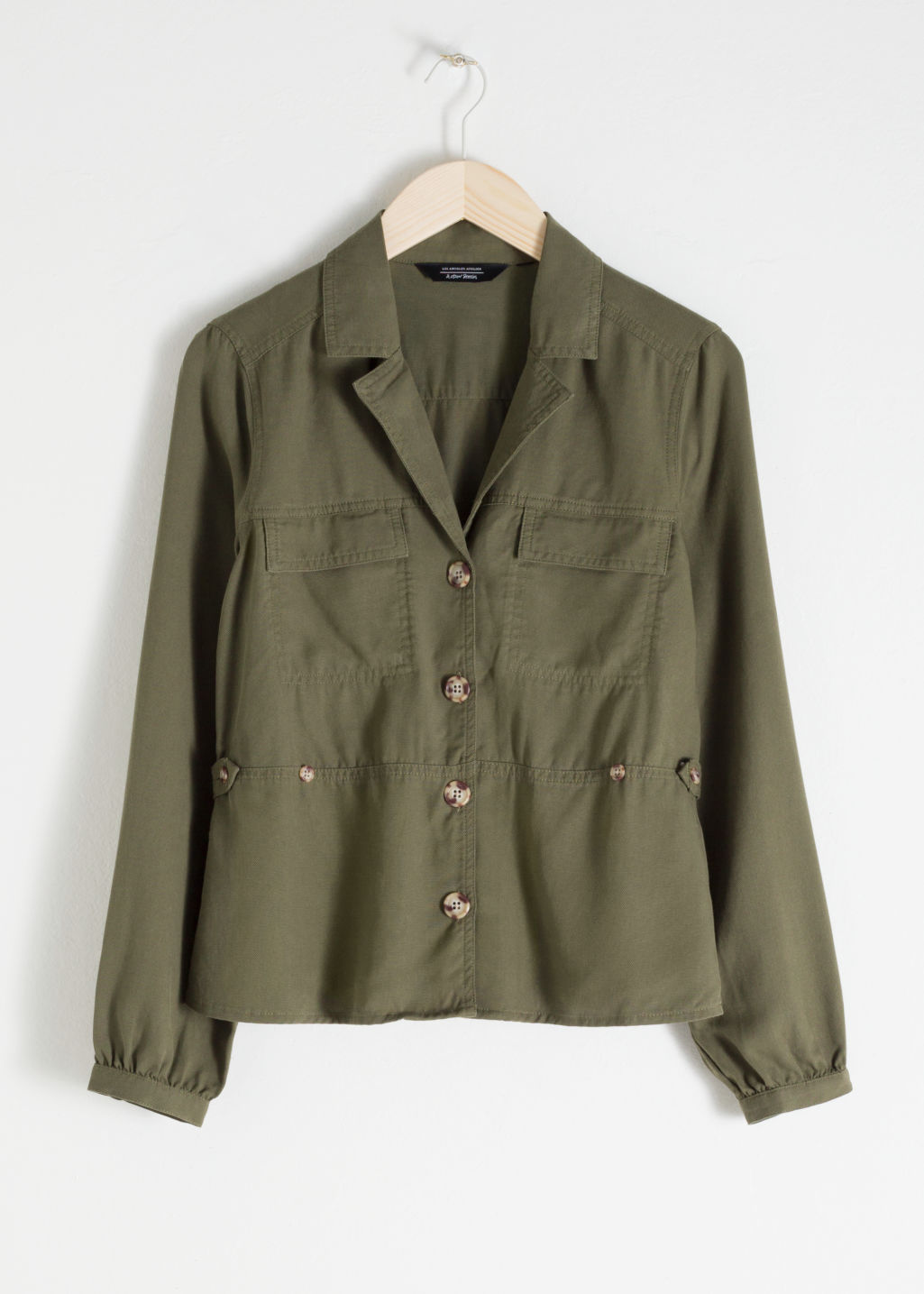 Front image of Stories workwear overshirt jacket in green