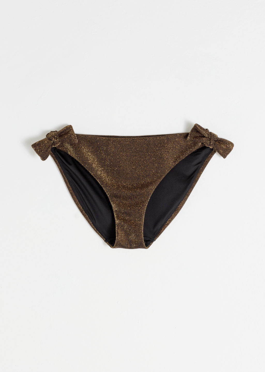 Front image of Stories glitter tie bikini briefs in gold