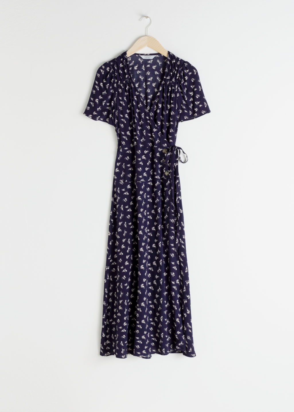 Front image of Stories flowy wrap midi dress in blue