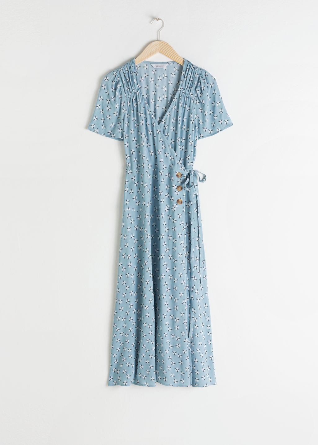 Front image of Stories flowy wrap midi dress in turquoise