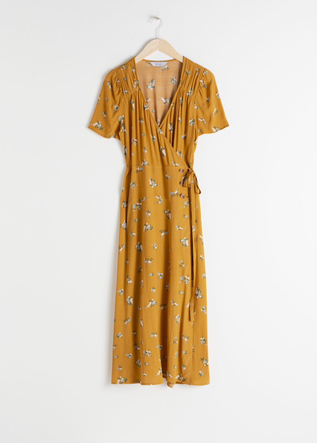 Front image of Stories flowy wrap midi dress in yellow