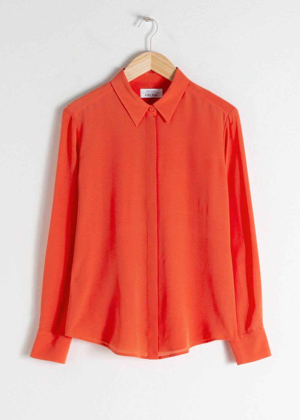 Front image of Stories straight fit silk shirt in orange
