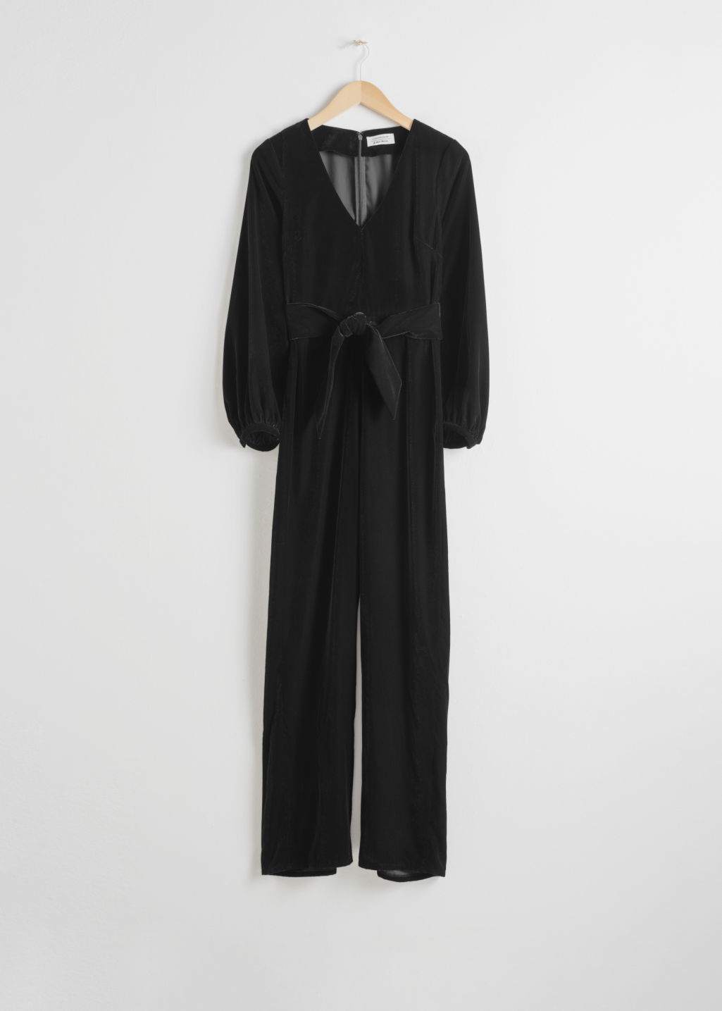 Front image of Stories plunging velvet jumpsuit in black