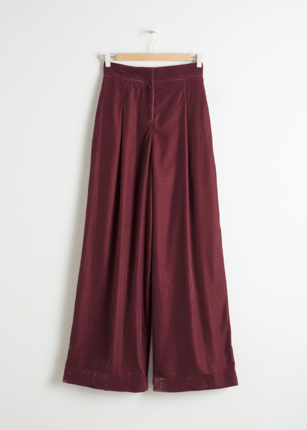 Front image of Stories high waisted velvet trousers in red