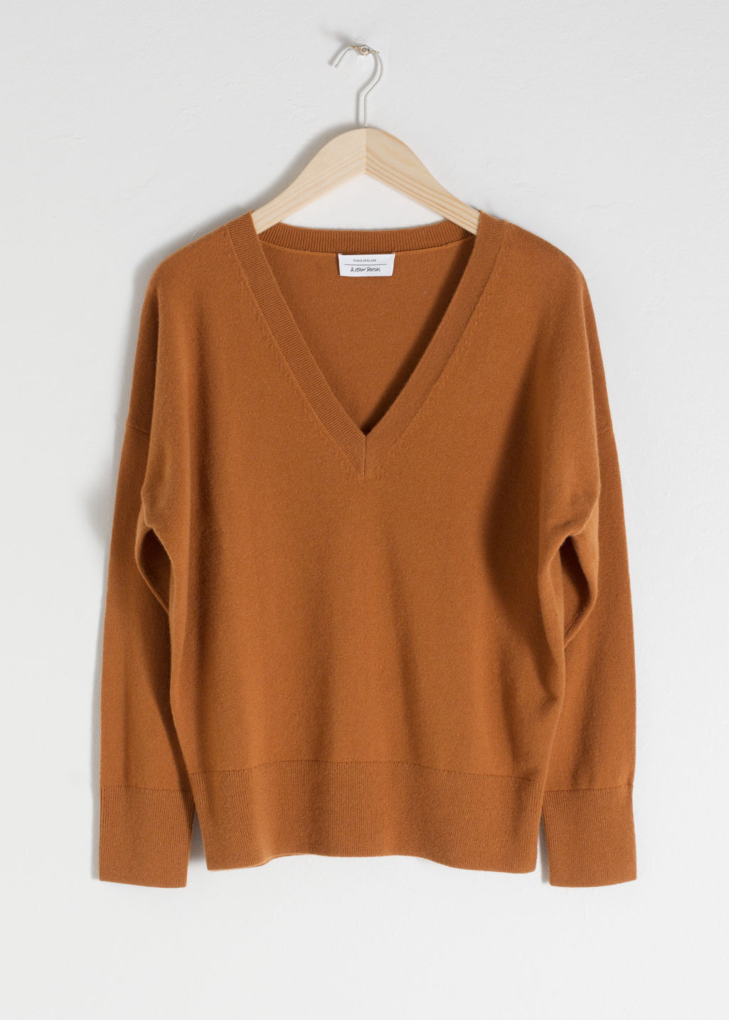 Front image of Stories v-neck cashmere sweater in orange