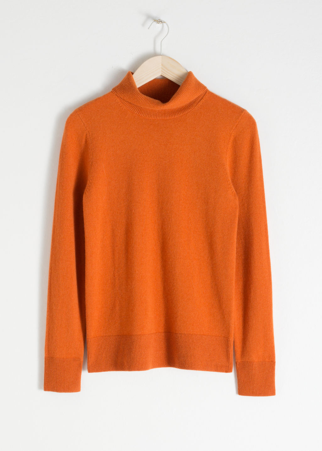Front image of Stories fitted cashmere turtleneck in orange
