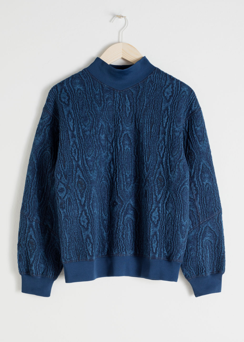 Front image of Stories wood jacquard mock neck sweater in blue