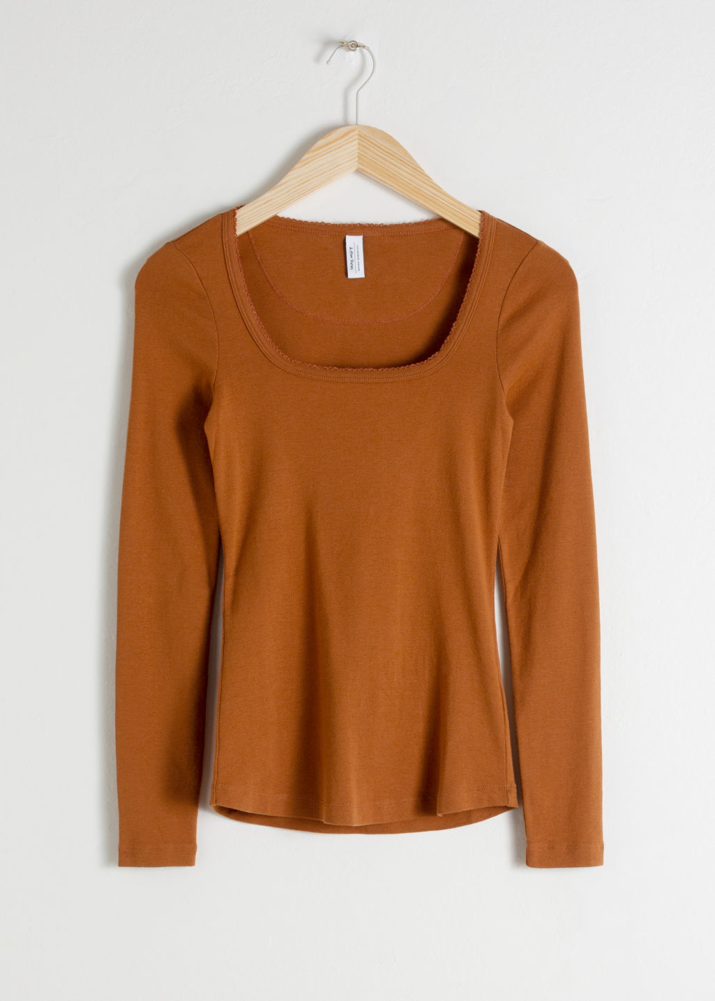 Front image of Stories organic cotton long sleeve top in orange