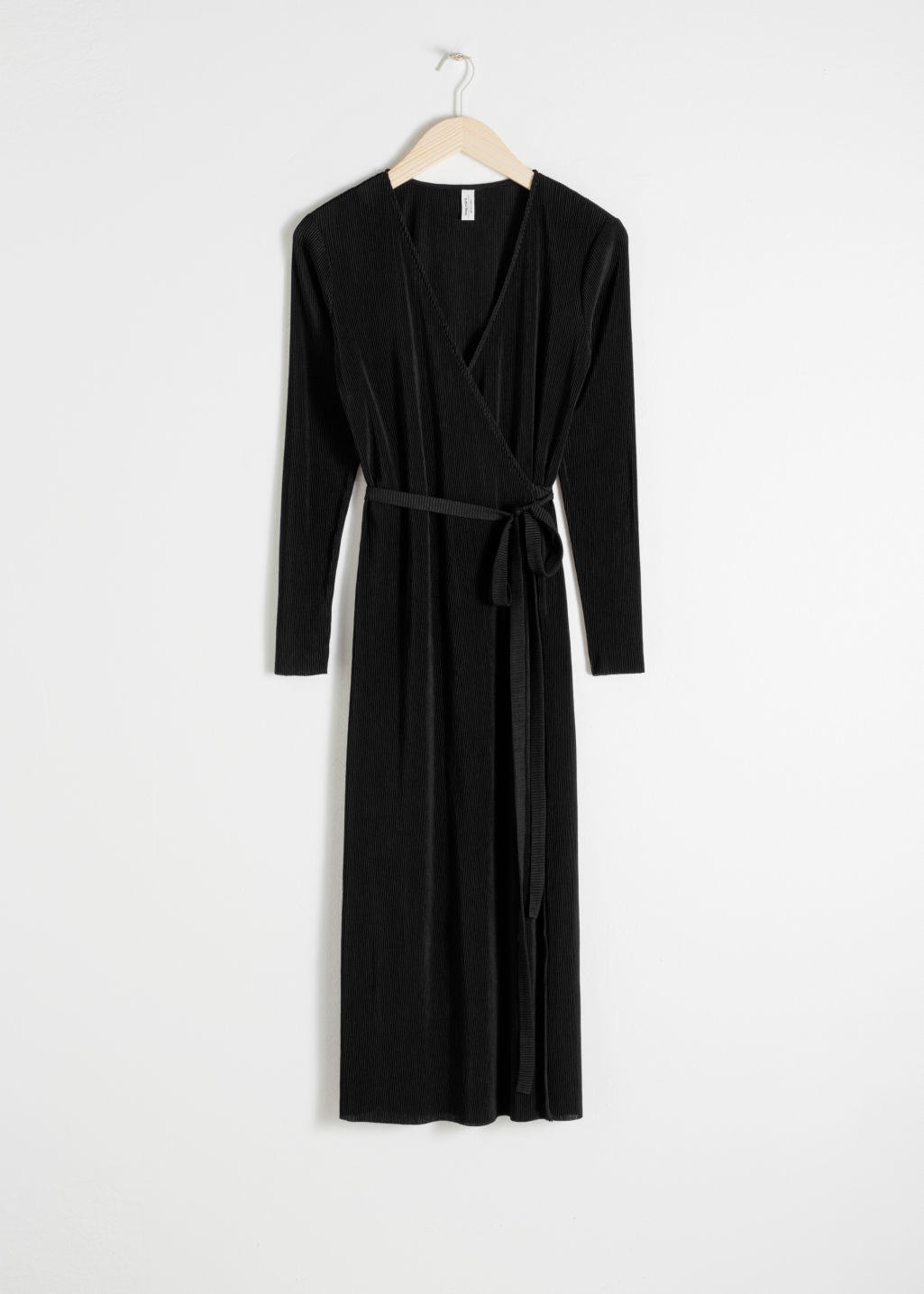 Front image of Stories plissé pleated wrap dress in black
