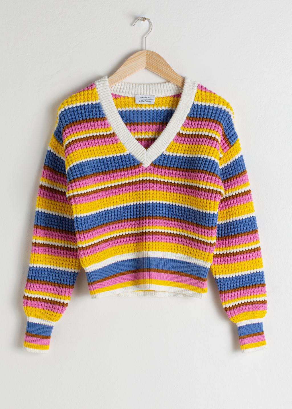 Front image of Stories cropped striped cotton blend sweater in white