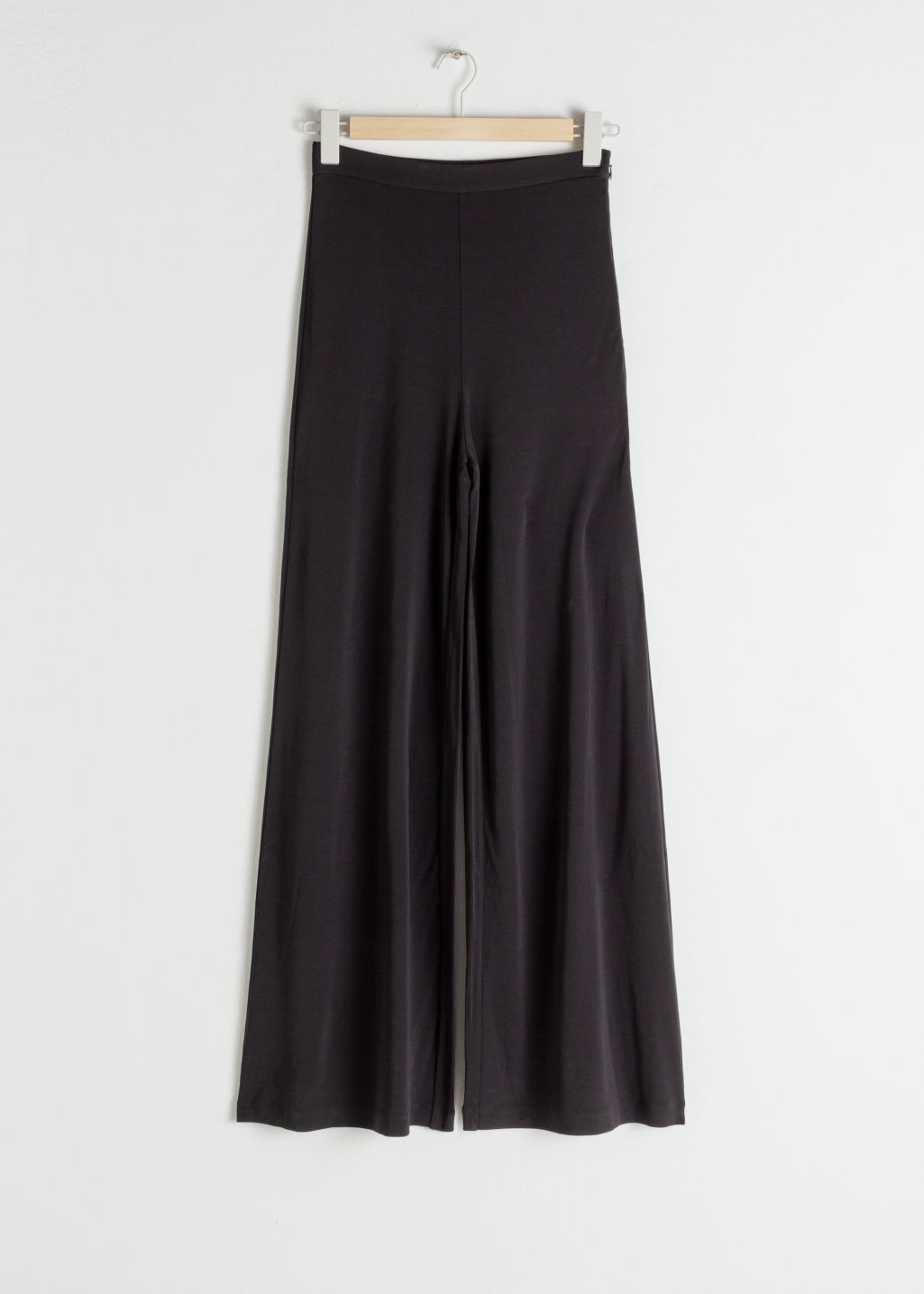 Front image of Stories high waisted flared trousers in black