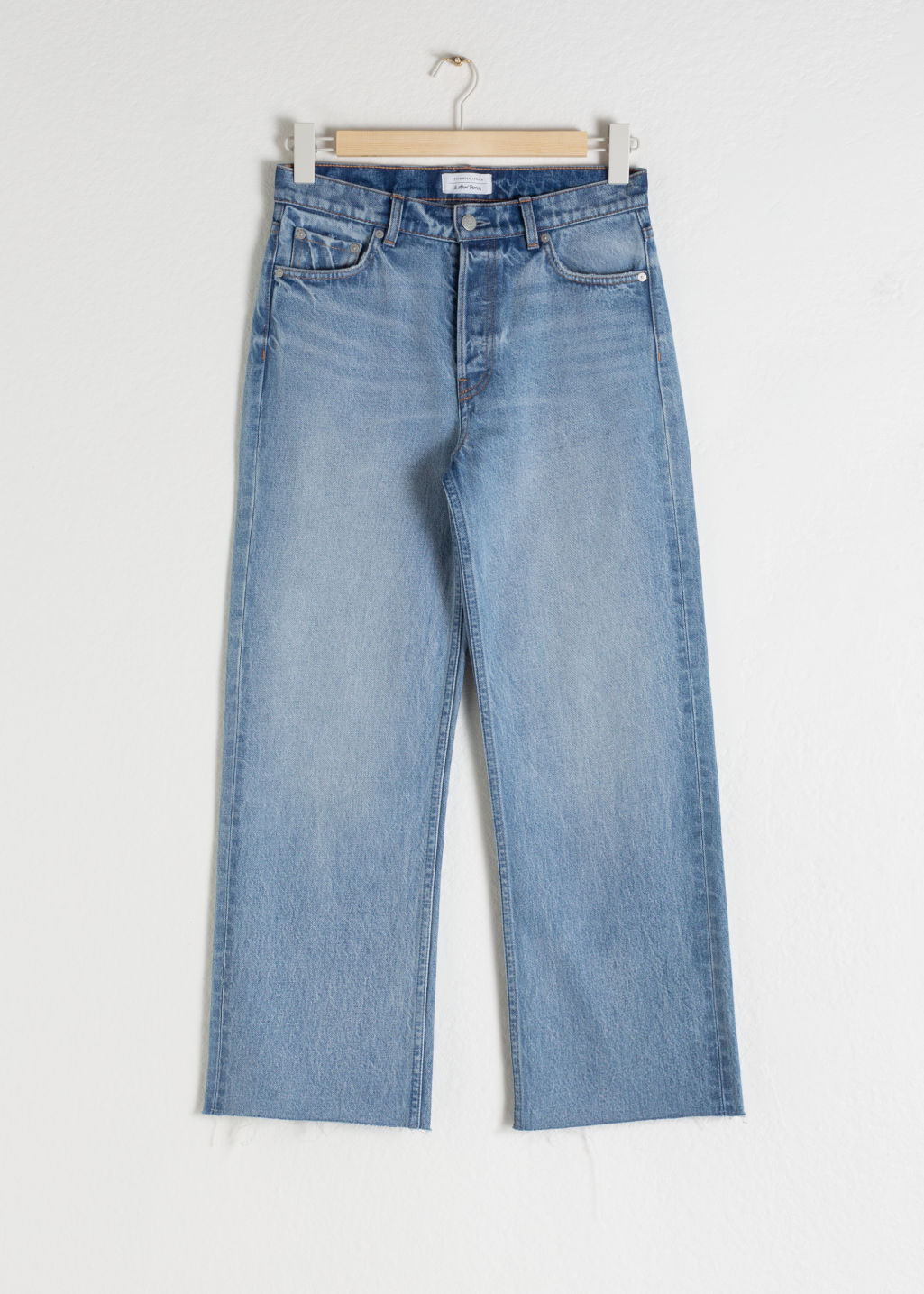 Front image of Stories kick flare mid rise jeans in blue