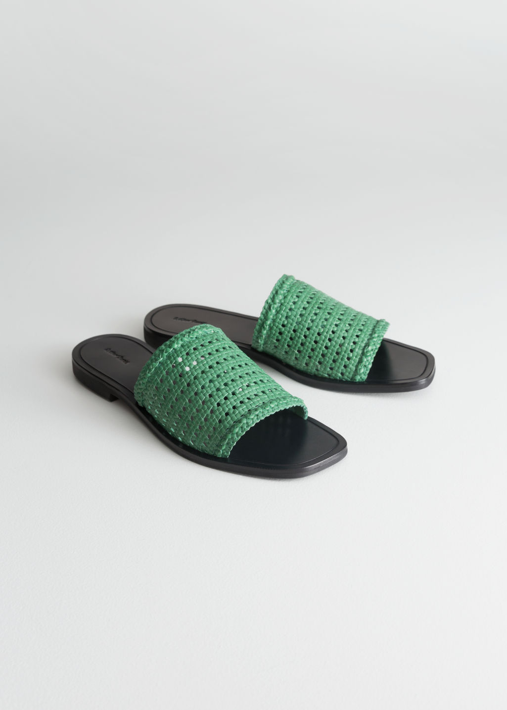 Front image of Stories square toe woven sandals in green