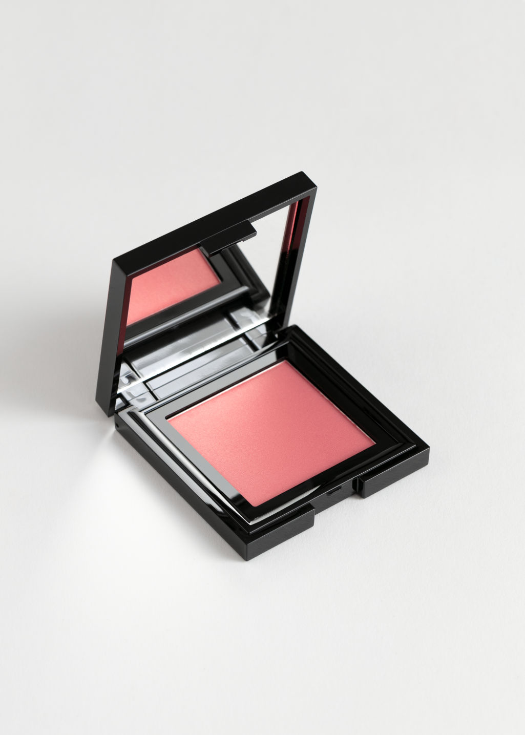 Front image of Stories blusher in red