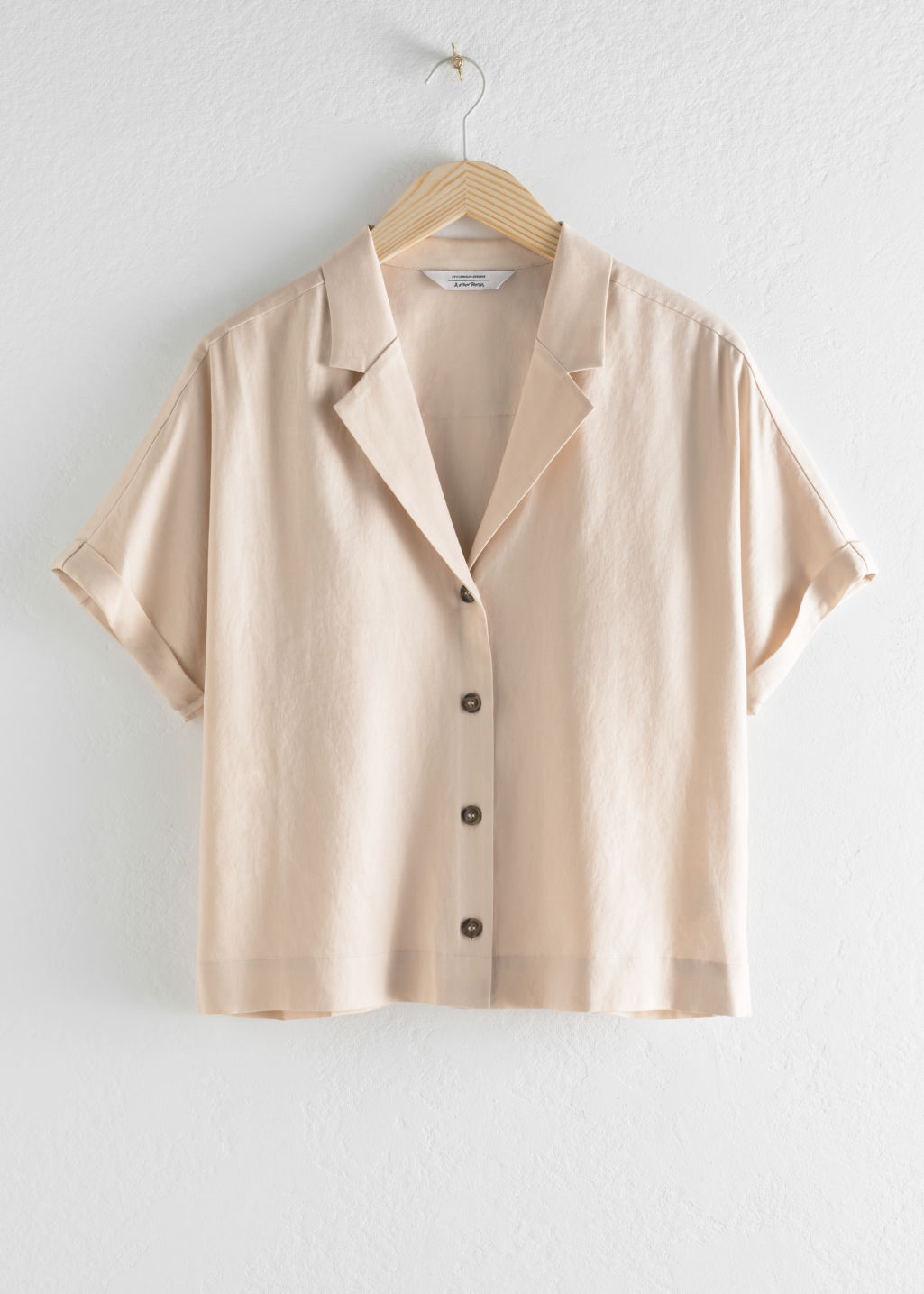 Front image of Stories v-cut button up shirt in beige