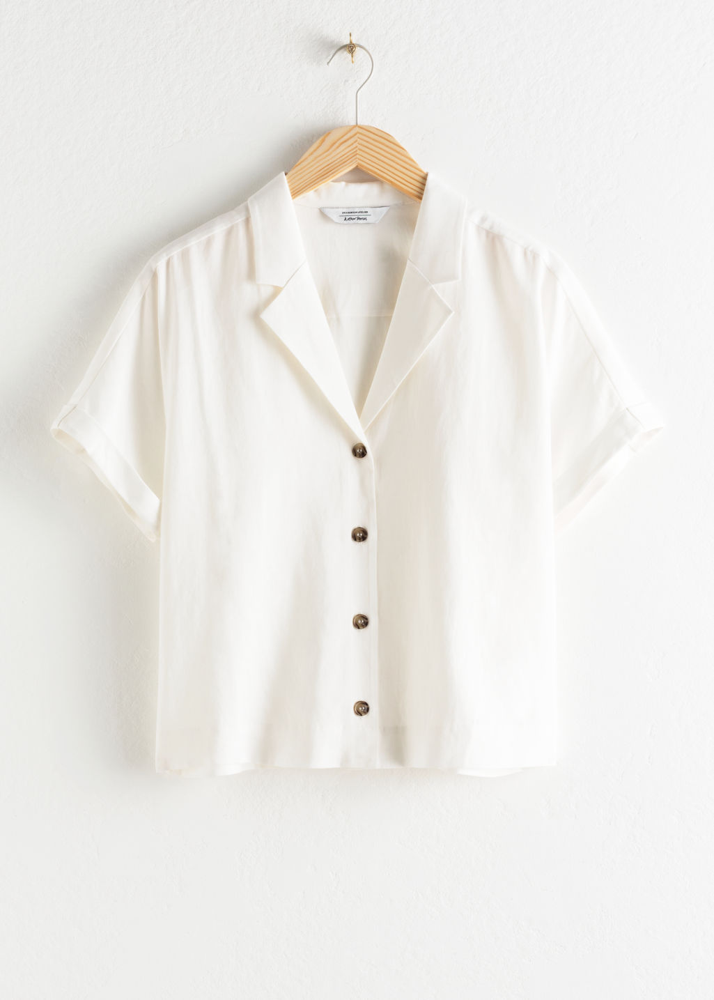 Front image of Stories v-cut button up shirt in white