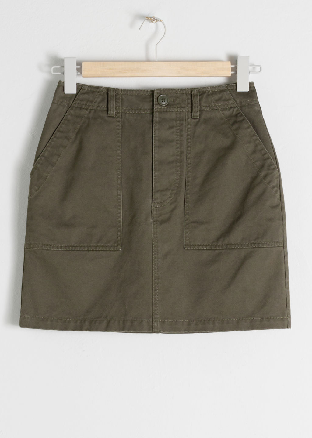 StillLife Front Image of Stories Cotton Workwear Mini Skirt in Green