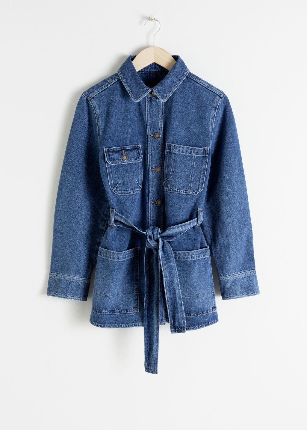 Front image of Stories belted workwear denim jacket in blue