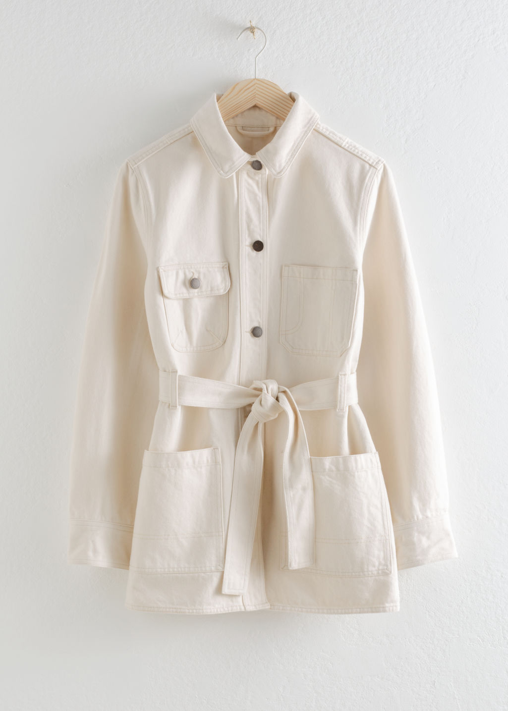 Front image of Stories belted workwear denim jacket in white