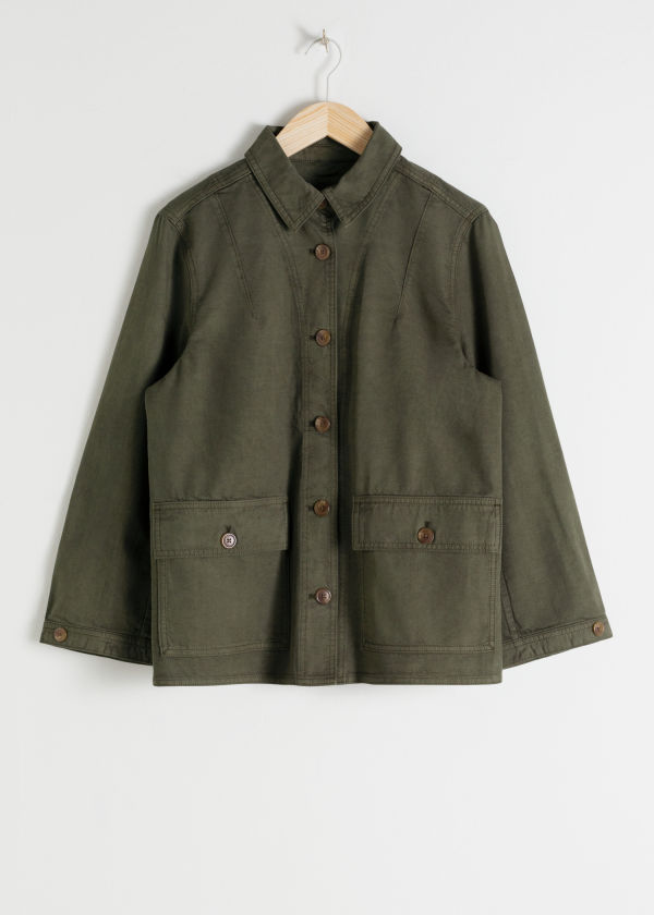 Front image of Stories organic cotton denim workwear jacket in green