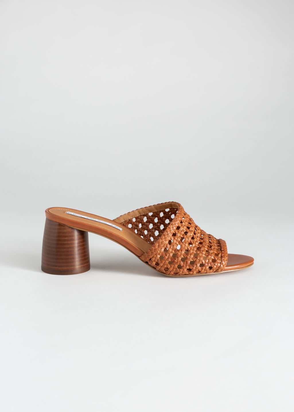 Front image of Stories woven leather heeled sandals in orange