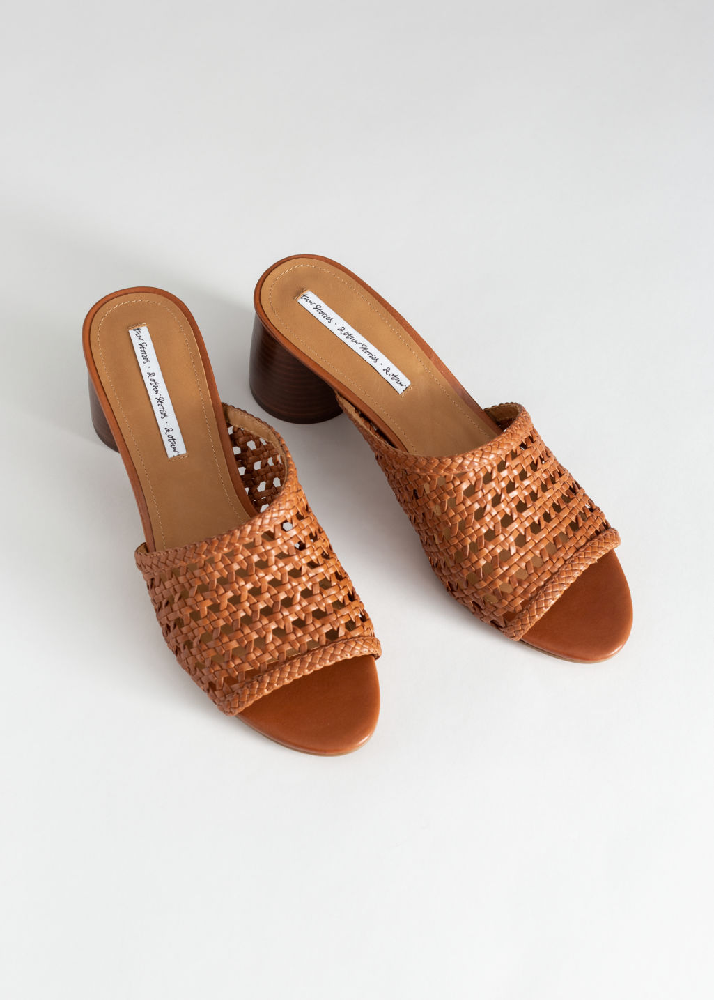 Back image of Stories woven leather heeled sandals in orange