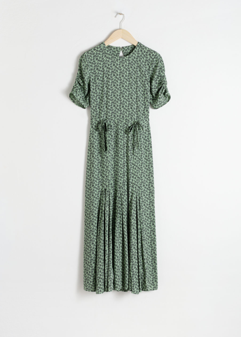 Front image of Stories open back floral midi dress in green